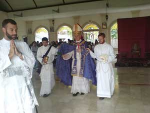 Bishop Williamson blessing the floor of Jaro Church